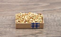 Buckwheat on wood Stock Photography