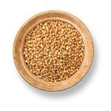 Buckwheat in wood plate Stock Photography