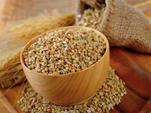 Buckwheat in wood scoop on table Stock Images
