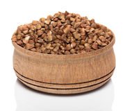 Buckwheat in wooden bowl Stock Images