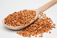 Buckwheat with a wooden spoon Stock Images