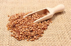 Buckwheat with wooden spoon on jute canvas Royalty Free Stock Image