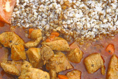 Buckwheats and gulash. Tasty meal Stock Images