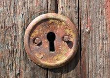 Buco della serratura di vecchio portello Fotografie Stock