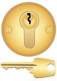 Buco della serratura e tasto dell'oro Immagini Stock