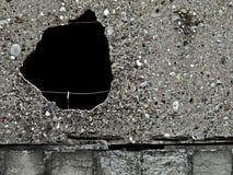 Buco nero in una parete Fotografia Stock
