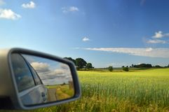 Bucolic Countryside Denmark reflected in car wing mirror