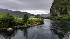 The bucolic Landscape of the Mostraumen Fjord, Norway - July 2017. The bucolic Landscape of the Mostraumen Fjord in Norway. View from the fjord cruise Bergen Stock Photography