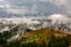 Bucovina autumn landscape in Romania with mist and mountains. After rainy day royalty free stock photography