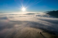Bucovina autumn sunrise landscape in Romania with mist and mountains royalty free stock photography