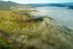 Bucovina autumn sunrise landscape in Romania with mist and mountains stock images