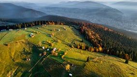 Bucovina autumn sunrise landscape in Romania with mist and mountains stock photo