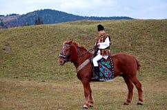Bucovinian boy on horse in Bucovina in traditional clothes. Bucovinian boy on horse in Bucovina Romania. Clothes in traditional in Bucovina Stock Images
