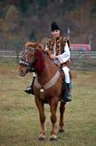 Bucovinian boy on horse in Bucovina in traditional clothes. Bucovinian boy on horse in Bucovina Romania. Clothes in traditional in Bucovina Royalty Free Stock Photography