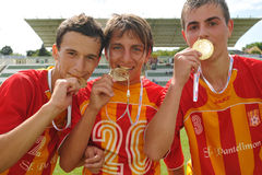 Bucuresti players show their medals. KAPOSVAR, HUNGARY - JULY 25: Bucuresti players show their medals at the V. Youth Football Festival Under 17 Final Royalty Free Stock Photo