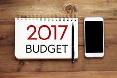 2017 budżetów słowo na notatnika papieru tle Obrazy Stock
