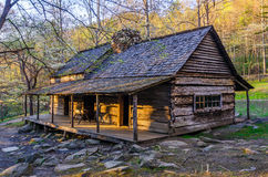 Bud Ogle Place, Roaring Fork Nature Trail, Great Smoky Mountains. Spring dogwoods bloom around the old Bud Ogle Cabin along the Roaring Fork Motor Nature Trail Royalty Free Stock Photography