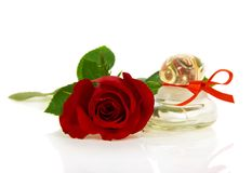 Bud of red rose and bottle with perfume Stock Photo