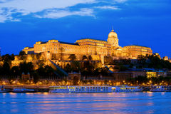 Buda Castle in Budapest. Buda Castle by the Danube river, illuminated at dusk in Budapest, Hungary Royalty Free Stock Images