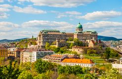 Buda Castle in Budapest. Hungary. View from Gellert Hill. Beautiful landscape with castle in cityscape of Budapest viewed through greenery of park royalty free stock images