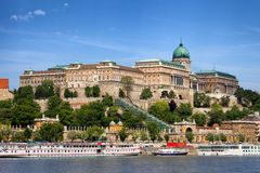 Buda Castle in Budapest. Buda Castle (Royal Palace) and passenger boats on the Danube River in Budapest, Hungary Royalty Free Stock Photo