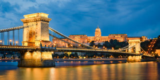 Buda Castle and Chain Bridge in Budapest, Hungary. Buda Castle and Chain Bridge at night in Budapest, Hungary Stock Photos