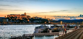 Buda Castle and the Danube. The illuminated Buda Castle and the Danube River at the beginning of the evening Stock Photography