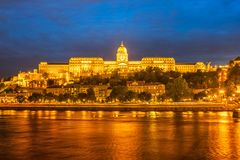 Buda Castle by the Danube river, illuminated at dusk. In Budapest, Hungary stock image