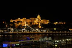 Buda Castle and Danube River by night, Budapest, Hungary, Europe. Buda Castle is a historical castle and palace complex of the Hungarian kings in Budapest. It stock images