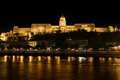Buda Castle and Danube river at Night, Budapest, Hungary. Night shot of the Buda Castle with the Danube river in the foreground and some beautiful reflections in stock photos