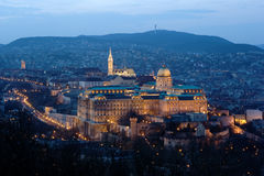 Buda Castle in floodlight in Budapest, Hungary. Buda Castle, Matthias Church and the Castle District with the hills of Buda in the background at dusk, in Stock Image