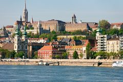 Buda Castle, FSt. Matthias church and Fishermen`s Bastion. Viewed from Danube river royalty free stock images
