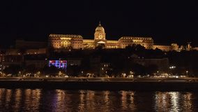 Buda Castle Hill at night, Budapest, Hungary. Pictured is the Buda Castle Hill at night from the River Danube, Budapest, Hungary. It is the historical castle and stock images