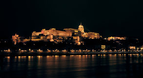 Buda Castle by night. Buda Castle seen across the Danube at night, Budapest, Hungary Stock Photo