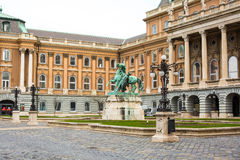 Buda Castle, Prince Eugene of Savoy statue. Budapest, Hungary - March 29, 2015: Buda Castle, horse statue of Prince Eugene of Savoy, people around in Budapest Royalty Free Stock Photo