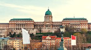 Buda Castle at sunset with warm cloudy sky. City buildings on bottom. Negative copy space, place for text. Budapest, Hungary stock photo