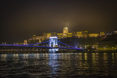 Buda castle. And Széchenyi Chain Bridge by night royalty free stock image