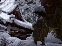 Buda coberto de neve, Kyoto Japão Fotografia de Stock