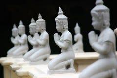 Buda de arrodillamiento en el palacio del rey Fotografía de archivo libre de regalías