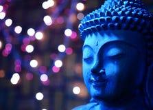 Buda de madera azul hace frente Foto de archivo libre de regalías