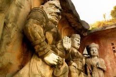 Buda de piedra grande en la pared de piedra en jardín del paisaje de Wuxi Yuantouzhu - de Taihu, China Imagen de archivo libre de regalías