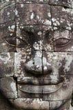 Buda de piedra hace frente Imágenes de archivo libres de regalías