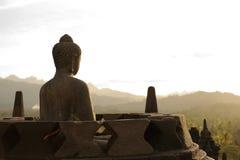 Buda en la puesta del sol, Borobudur Fotografía de archivo libre de regalías