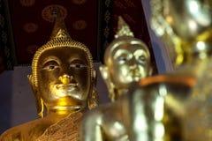 Buda hace frente a public domain en Bangkok Foto de archivo