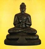 Buda negro con el fondo de oro Fotos de archivo libres de regalías