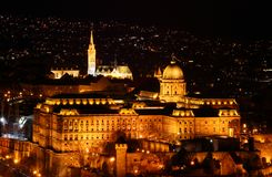 Buda Royal Palace and Matthias Church in evening on Castle Hill. Buda Castle Hill evening elevated view with Baroque Royal Palace buildings and Gothic Matthias stock image