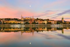 Buda side of Budapest city reflecting in still river royalty free stock images