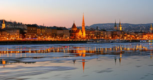 Buda side at sunset over the icy Danube River, Budapest, Hungary Stock Photos