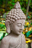 Buda statue. Closeup of buda statue in garden Stock Photos
