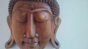 Buda tallado hace frente a 2 imagen de archivo libre de regalías